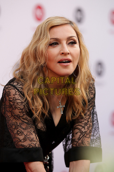 Madonna.Madonna opens Hard Candy Fitness fitness-club, Moscow, Russia..August 6th, 2012.half length black dress lace mouth open bending leaning cross crucifix necklace .CAP/PER/AS.©AS/PersonaStars/CapitalPictures