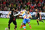 der Leverkusener Kevin Volland mit dem Mainzer Moussa Niakhate am Ball beim Spiel in der Fussball Bundesliga, 1. FSV Mainz 05 - Bayer 04 Leverkusen (dunkel).<br /> <br /> Foto &copy; PIX-Sportfotos *** Foto ist honorarpflichtig! *** Auf Anfrage in hoeherer Qualitaet/Aufloesung. Belegexemplar erbeten. Veroeffentlichung ausschliesslich fuer journalistisch-publizistische Zwecke. For editorial use only. DFL regulations prohibit any use of photographs as image sequences and/or quasi-video.
