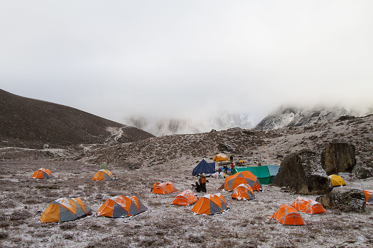 Morning basecamp after a light snow fall.  Photo by Didrik Johnck.