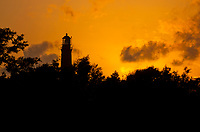 The Pensacola Lighthouse prepares for a night of work as the sun sets. It has served as an aide to navigation since 1859. <br /> <br /> <br /> COLIN HACKLEY PHOTO