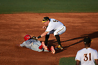 Bradenton Marauders second baseman Mitchell Tolman (5) tags Derek Campbell (25) as he slides back into second base during a game against the Clearwater Threshers on July 24, 2017 at LECOM Park in Bradenton, Florida.  Bradenton defeated Clearwater 6-3  (Mike Janes/Four Seam Images)