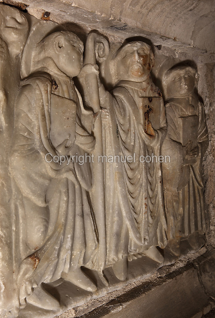St Sernin giving his crozier to his disciple St Honest, with St Papoul on the right, all about to leave to spread the gospel to the pagans, holding the book of the Evangelists, on the sarcophagus of St Sernin, by the Master of Cabestany in Romanesque style, mid 12th century, in the Saint-Hilaire-D'Aude Abbey, built 11th - 14th centuries and closed 1748, when it became a parish church, Saint-Hilaire, Aude, Languedoc-Roussillon, France. St Hilary built the first chapel on this site in the 6th century, dedicated to St Sernin. In the 10th century his relics were discovered here and the church, then an abbey, rededicated to St Hilaire. Picture by Manuel Cohen
