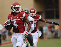 NWA Media/ANDY SHUPE - Arkansas receiver Keon Hatcher (4) heads to the end zone during the first quarter Saturday, Sept. 6, 2014, at Razorback Stadium in Fayetteville