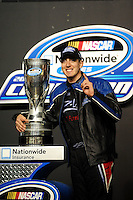 Nov. 21, 2009; Homestead, FL, USA; NASCAR Nationwide Series driver Kyle Busch celebrates after winning the 2009 championship following the Ford 300 at Homestead Miami Speedway. Mandatory Credit: Mark J. Rebilas-