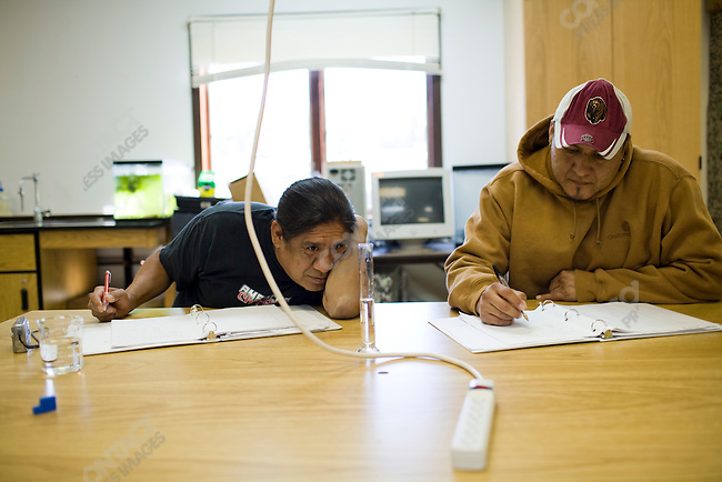 Richard Littlebird (left) and Wayne Strangeowl work together in a class on the campus of Chief Dull Knife College in the town of Lame Deer, Montana which is on the Northern Cheyenne Indian Reservation.