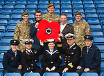 Rangers on parade for remembrance ahead of Saturday's match where 400 members of the armed forces are invited to Ibrox along with veterans from Erskine. ..Pictured are( front) cpl Gordon Campbell RAF, CPO Kevin Shenton HM Naval Base Clyde, Leading Hand Angela Comrie RN HQ Rosyth, Commander John Livesey HMS Victorious, Flight Lt Nicholas Page RAF, (back) private Stuart Hamilton 6 Scots, leading striker first class Lee McCulloch, Major Barry Henderson MBE 7 Scots, General in Chief (RFC HQ) Ally McCoist MBE, W/O Jim Chisholm Glasgow University OTC