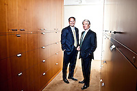 Portraits of Charles Schwab and Walter Bettinger 2009