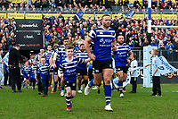 Jamie Roberts of Bath Rugby mascot in hand runs out onto the field. Gallagher Premiership match, between Bath Rugby and Harlequins on March 2, 2019 at the Recreation Ground in Bath, England. Photo by: Patrick Khachfe / Onside Images