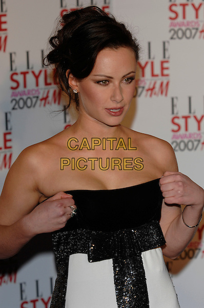 CAMILLA AL FAYED.Inside - ELLE Style Awards,.The Roundhouse, Chalk Farm Road, .London, England, February 12th 2007..half length strapless black and white striped dress pulling up.CAP/PL.©Phil Loftus/Capital Pictures