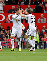 Pictured L-R: Ki Sung Yueng of Swansea celebrating his opening goal with team mate Angel Rangel. Saturday 16 August 2014<br /> Re: Premier League Manchester United v Swansea City FC at the Old Trafford, Manchester, UK.