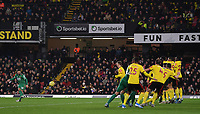 1st January 2020; Vicarage Road, Watford, Hertfordshire, England; English Premier League Football, Watford versus Wolverhampton Wanderers;  Joao Moutinho of Wolverhampton Wanderers takes a free kick over the Watford defensive wall - Strictly Editorial Use Only. No use with unauthorized audio, video, data, fixture lists, club/league logos or 'live' services. Online in-match use limited to 120 images, no video emulation. No use in betting, games or single club/league/player publications