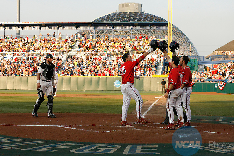 25 JUNE 2008:  Teammates congratulate Steve Detwiler (15) of Fresno State University after his home run against the University of Georgia during the Division I Men's Baseball Championship held at Rosenblatt Stadium in Omaha, NE.  Fresno State defeated Georgia 6-1 for the national title.  Jamie Schwaberow/NCAA Photos
