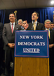 Albertson, New York, U.S. 26th October 2013. New York Governor ANDREW CUOMO, at podium, endorses TOM SUOZZI, at left, for Nassau County Executive, Foreign Wars VFW Post. Democrat Suozzi, the former Nassau County Executive, and Republican incumbent Mangano face each other in a rematch in the upcoming November 5th election.