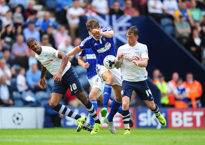 Preston North End's Jermaine Beckford, left, and Preston North End's Joe Garner vies for possession with Ipswich Town's Christophe Berra<br /> <br /> Photographer Chris Vaughan/CameraSport<br /> <br /> Football - The Football League Sky Bet Championship - Preston North End v Ipswich Town - Saturday 22nd August 2015 - Deepdale - Preston<br /> <br /> &copy; CameraSport - 43 Linden Ave. Countesthorpe. Leicester. England. LE8 5PG - Tel: +44 (0) 116 277 4147 - admin@camerasport.com - www.camerasport.com