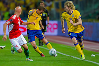 Hungary's Jozsef Varga (L) fights for the ball with Sweden's Kim Kallstrom (C) and Christian Wilhelmsson (R) during the UEFA EURO 2012 Group E qualifier Hungary playing against Sweden in Budapest, Hungary on September 02, 2011. ATTILA VOLGYI