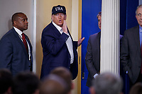 US President Donald J. Trump responds to a question from the news media during a press conference in the press briefing room at the White House in Washington, DC, USA, 14 March 2020. To date there are 2175 confirmed cases of COVID-19 coronavirus in the US with 50 deaths.<br /> Credit: Shawn Thew / Pool via CNP/AdMedia