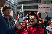 NEW YORK,NY October 29,2016. A woman talks live for a social media platform, during  a rally for Donald Trump outside of Trump Tower in Manhattan, October 29,2016. Photo by VIEWpress/Maite H. Mateo
