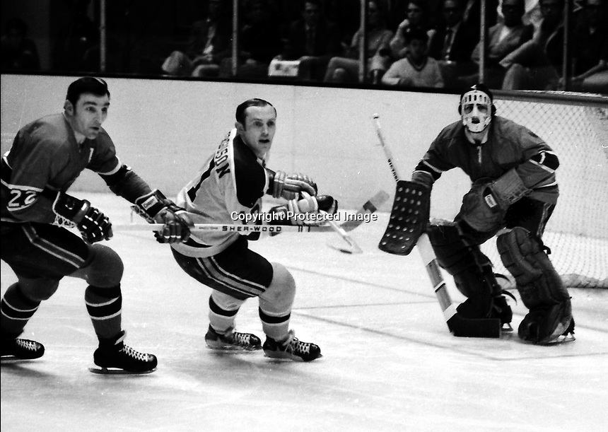 Seals vs Montreal, Canadiens John Ferguson #22, and goalie Rogie Vaachon...Seals Norm Ferguson  (1971 Photo/Ron Riesterer)