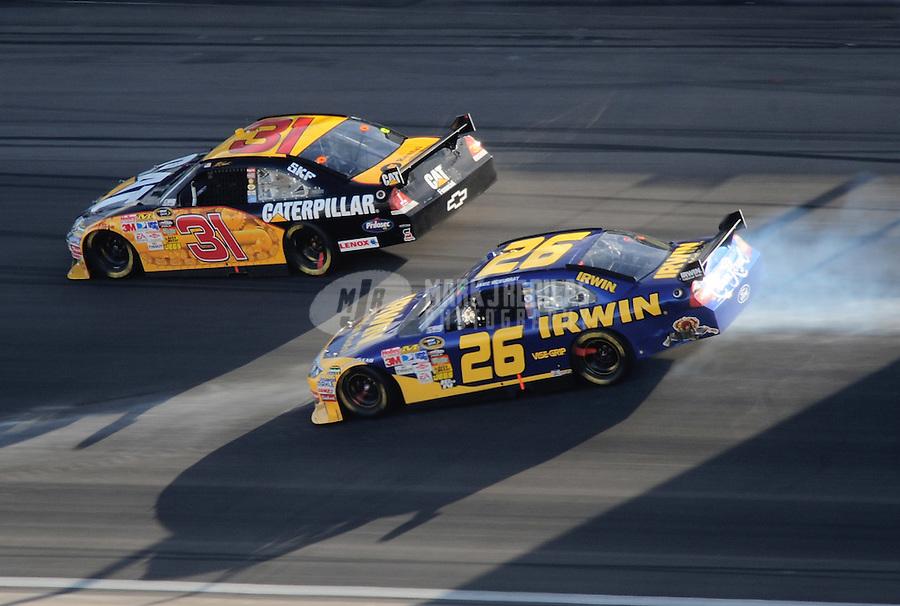 Mar. 1, 2009; Las Vegas, NV, USA; NASCAR Sprint Cup Series driver Jamie McMurray (26) slides sideways as Jeff Burton (31) goes high during the Shelby 427 at Las Vegas Motor Speedway. Mandatory Credit: Mark J. Rebilas-