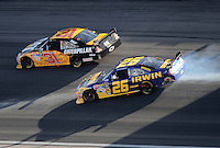 Mar. 1, 2009; Las Vegas, NV, USA; NASCAR Sprint Cup Series driver Jamie McMurray (26) slides sideways as Jeff Burton (31) goes high during the Shelby 427 at Las Vegas Motor Speedway. Mandatory Credit: Mark J. Rebilas-