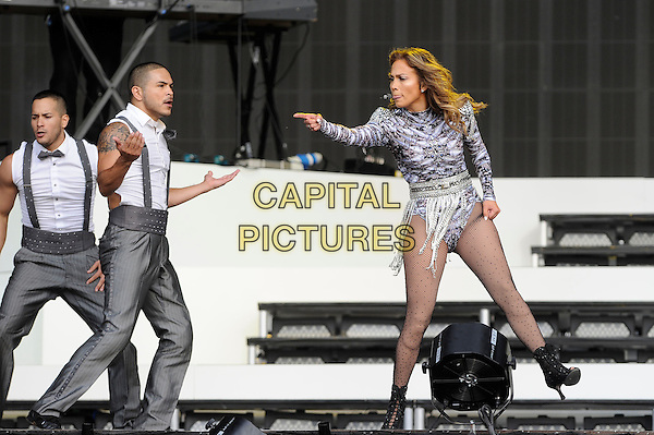 Jennifer Lopez <br /> performing at Barclaycard British Summertime, Hyde Park, London, England. <br /> 14th July 2013<br /> on stage in concert live gig performance music full length silver purple leotard tights dancing singing backup dancers hand arm pointing  j-lo<br /> CAP/MAR<br /> &copy; Martin Harris/Capital Pictures