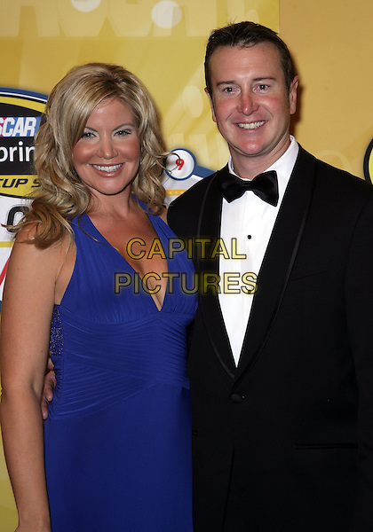 EVA & KURT BUSCH.Attending the 2009 NASCAR Sprint Cup Awards Ceremony at the Wynn Las Vegas, Las Vegas, Nevada , USA, .4th December 2009..half length blue dress black bow tie couple married husband wife .CAP/ADM/MJT.© MJT/AdMedia/Capital Pictures.
