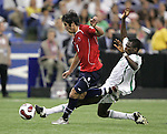 15 July 2007: Nigeria's Chukwuma Akabueze (right) tackles the ball away from Chile's Mauricio Isla. Chile's Under-20 Men's National Team defeated Nigeria's Under-20 Men's National Team 4-0 after extra time in a  quarterfinal match at Olympic Stadium in Montreal, Quebec, Canada during the FIFA U-20 World Cup Canada 2007 tournament.