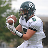 Rick Conway #5 of Lindenhurst fields the opening kickoff of the second half before returning it 76 yards to the 14-yard line in a Suffolk County Division I varsity football game against Northport at Glenn High School on Saturday, Sept. 2, 2017.