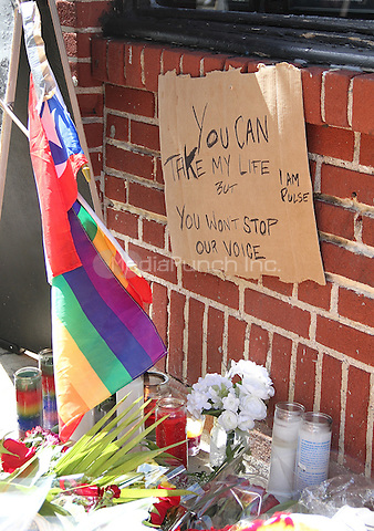 NEW YORK, NY - JUNE 13: Memorial for victims of Orlando, Florida mass shooting victims at the LGBT nightclub Pulse outside of LGBT landmark Stonewall Inn in New York, New York on June 13, 2016.  Photo Credit: Rainmaker Photo/MediaPunch