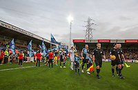 The Teams head onto the pitch during the Sky Bet League 2 match between Wycombe Wanderers and Oxford United at Adams Park, High Wycombe, England on 19 December 2015. Photo by Andy Rowland.