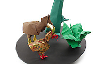 Detail of Origami model.<br /> Dodos designed by Roman Diaz (modified), folded by Rosalind Joyce<br /> Woodpecker designed by Muneji Fuchimoto, folded by Rosalind Joyce<br /> Fern designed by Yuri Shumakov, folded by Alice Fornari<br /> Tree designed by John Montroll, folded by Rosalind Joyce