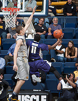 David Kravish of California tries to block Washington's Mike Anderson's shot during the game at Haas Pavilion in Berkeley, California on January 15th 2014.  California defeated Washington, 82-56.