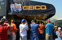 Sept. 22, 2012; Ennis, TX, USA: NHRA nitro fans gather at the pits of top fuel dragster driver Morgan Lucas during qualifying for the Fall Nationals at the Texas Motorplex. Mandatory Credit: Mark J. Rebilas-
