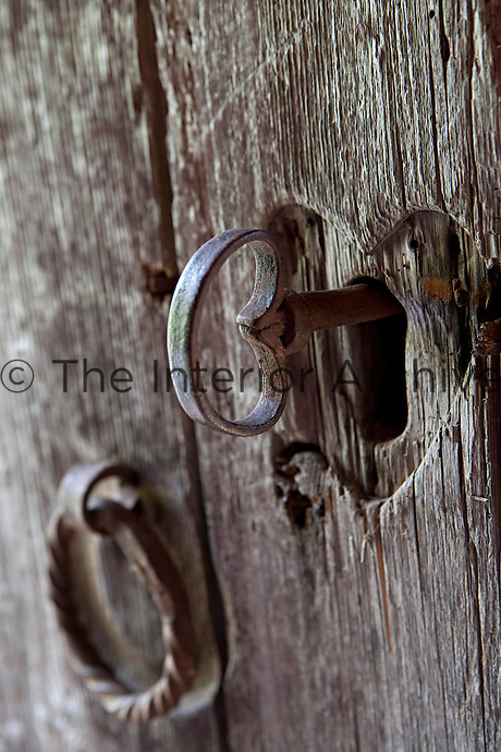 An 18th century weathered wooden door heralds the entrance to the cabin, its keyhole carved in the shape of a heart