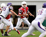 BRANDON, SD - SEPTEMBER 5: Alex Waltner #10 from Brandon Valley looks for a receiver in the first half against Watertown Saturday night in Brandon. (Photo by Dave Eggen/Inertia)