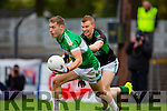 Tom Moriarty Legion gets to the ball ahead of Aidan o'Reilly  Nemo Rangers during the AIB Munster club SFC clash in Pairc Uí Rinn on Sunday