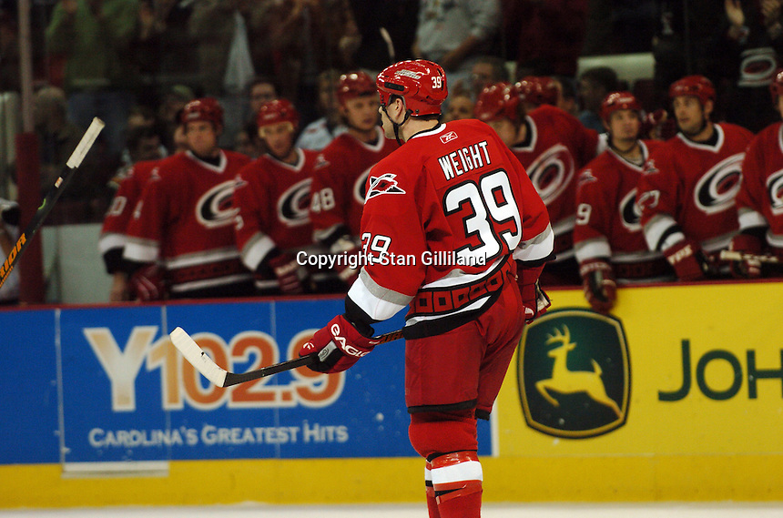 Carolina Hurricanes' Doug Weight skates back to center ice after scoring his second goal against the New York Rangers Tuesday, March 14, 2006 at the RBC Center in Raleigh, NC. Carolina won 5-3.