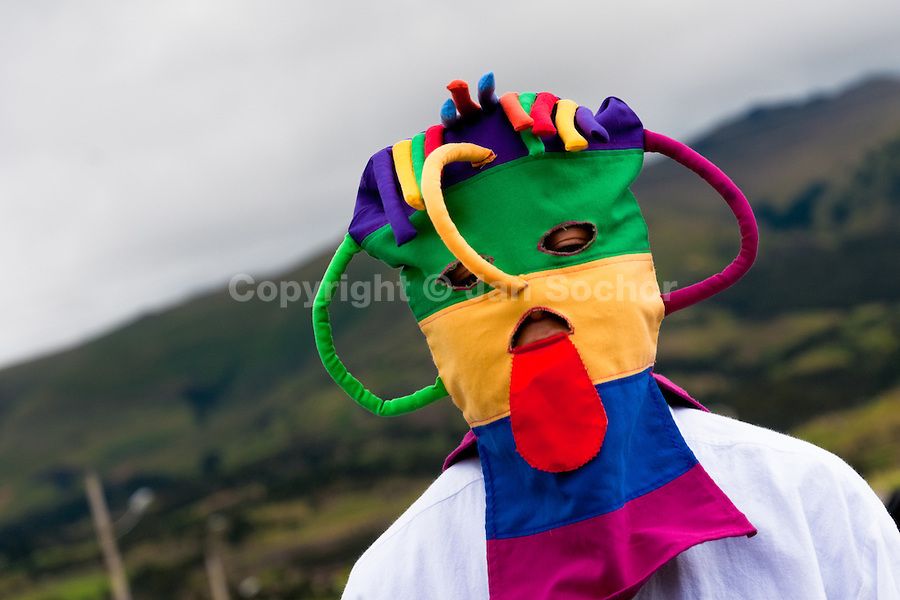 """A man dancer, wearing a colorful masque, performs Aya Uma - the creature from the Indian myths, during the Inti Raymi fiesta in Pichincha province, Ecuador, 26 June 2010. Inti Raymi, """"Festival of the Sun"""" in Quechua language, is an ancient spiritual ceremony held in the Indian regions of the Andes, mainly in Ecuador and Peru. The lively celebration, set by the winter solstice, goes on for various days. The highland Indians, wearing beautiful costumes, dance, drink and sing with no rest. Colorful processions in honor of the God Inti (Sun) pass through the mountain villages giving thanks for the harvest and expressing their deep relation to the Mother Earth (Pachamama)."""