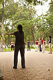 VIETNAM, Hanoi, women stretch and exercise early in the morning, Hoan Kiem Lake