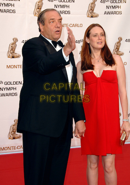 DICK WOLF & GUEST.At the Golden Nymph awards ceremony during the 2008 Monte Carlo Television Festival held at Grimaldi Forum, Monte Carlo, Principality of Monaco, .June 12, 2008..half length red dress hand funny waving tuxedo.CAP/TTL .©TTL/Capital Pictures