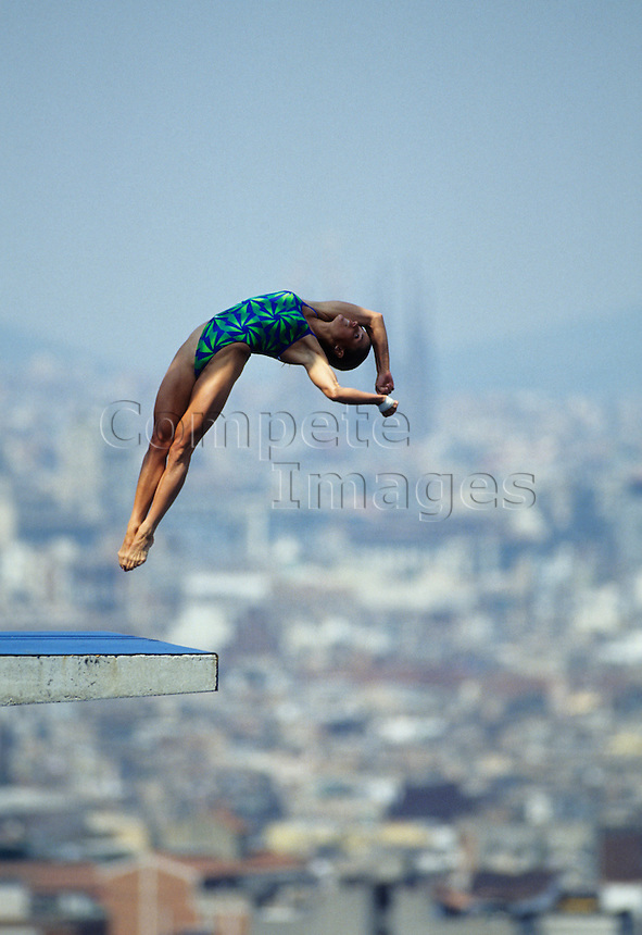 Woman doing flip in midair while diving
