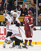 Wade MacLeod (Northeastern - 19), Tyler McNeely (Northeastern - 94) and Steve Silva (Northeastern - 17) celebrate Silva's goal. - The Northeastern University Huskies defeated the Harvard University Crimson 4-0 in their Beanpot opener on Monday, February 7, 2011, at TD Garden in Boston, Massachusetts.