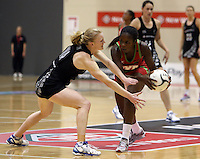 24.10.2013 Silver Fern Shannon Francois and Malawi's Joanna Kachilika in action during the Silver Ferns V Malawi New World Netball Series played at the TSB Bank Arena in Wellington. Mandatory Photo Credit ©Michael Bradley.