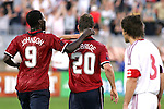 28 May 2006: U.S. forward Eddie Johnson (9) congratulates teammate Brian McBride (20) on his 43rd minute goal. The United States Men's National Team defeated Latvia 1-0 at Rentschler Field in East Hartfort, Connecticut in an international friendly soccer match.