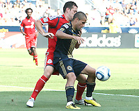 Fuad Ibrahim #7 of the Philadelphia Union shields the ball from Nick LaBrocca #21 of Toronto FC during an MLS match at PPL stadium in Chester, PA. on July 17 2010. Union won 2-1 with a last minute penalty kick goal.
