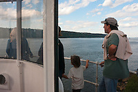 New York, NY -  11 October 2009- Visitors view the Hudson River and the Palisades on a tour of the Little Red Light House, at Jeffrey's Hook, for Open House New York.  The Little Red Lighthouse and the Great Grey Bridge were imortalized in a children's book by Hildegarde Swift and Lynd Ward. The lighthouse is a New York City landmark and is included in the National Register of Historic Places