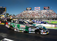 Mar 14, 2014; Gainesville, FL, USA; NHRA funny car driver John Force (near) races alongside teammate Robert Hight during qualifying for the Gatornationals at Gainesville Raceway Mandatory Credit: Mark J. Rebilas-USA TODAY Sports
