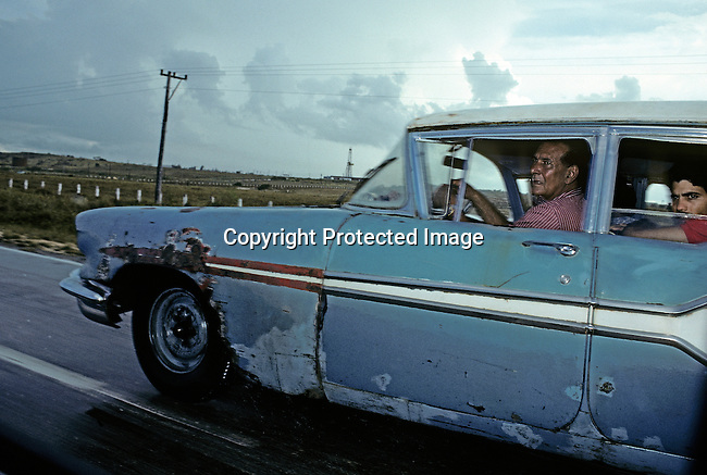 An unidentified family drives in their old American car on July 5, 1993 outside central Havana, Cuba. The country has seen a severe drop in economic growth since the expiration of aid from the former Soviet Union after the end of communism. Fidel Castro has ruled the communist island for over 4 decades and been in war of words with the United States all since then. They country have a good education and medical level but lacks freedom of the press and speech. (Photo by: Per-Anders Pettersson)