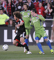 D.C. United midfielder Nick DeLeon (18) cover by Seattle Sounders defender Zach Scott (20) D.C. United tied the Seattle Sounders, 0-0 at RFK Stadium, Saturday April 7, 2012.