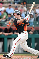 Buster Posey #28 of the San Francisco Giants bats against the Arizona Diamondbacks in the first spring training game of the season at Scottsdale Stadium on February 25, 2011  in Scottsdale, Arizona. .Photo by:  Bill Mitchell/Four Seam Images.